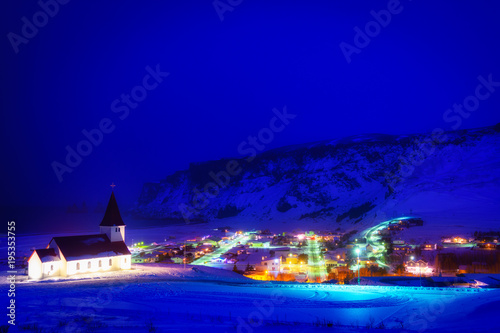 Fotobehang Violet beautiful town of vik i Myrdal on winter night, iceland