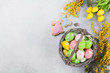 Easter eggs and yellow flowers. Greeting card - 195354921