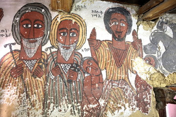 wall mural of saints and iconographic scenes, painted in naive african christian style, on church wall in Ethiopia