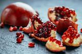 Fresh ripe pomegranate on a slate plate kitchen table