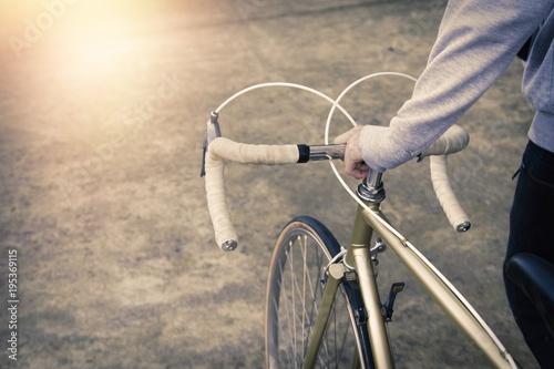 Plexiglas Fiets young athlete's hand with bicycle, lifestyle and sport
