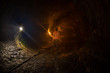 Woman Standing in a Lava Tube on the Island of Hawaii