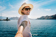 Girl traveler keeps your boyfriend on the holiday by the sea. Follow me  on vacation.
