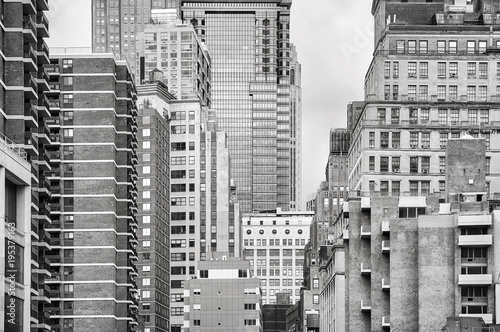 Black and white picture of the New York City buildings, USA.