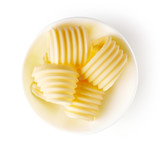 Butter curls isolated on white, from above - 195390500
