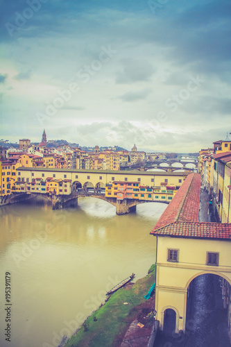 Deurstickers Toscane Ponte Vecchio bridge over Arno River with dark cloudy sky background in Florence,Tuscany, Italy - view from Uffizzi Galleries