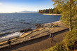 People doing sports and relaxing along the seawall in Stanley Park, Vancouver