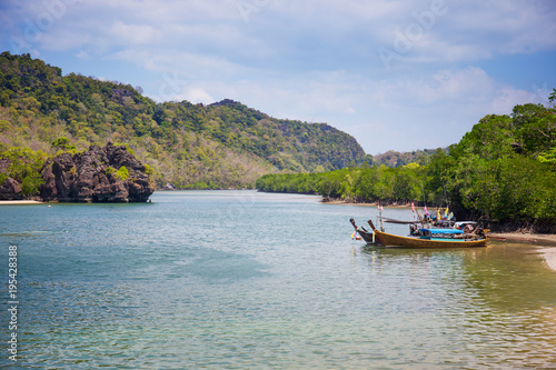 Fotobehang Thailand Summer beach with clearly sea and blue sky at Tarutao national park Satun, Thailand. Using for summer background