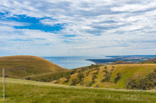 Keuken foto achterwand Blauwe hemel Picturesque view on countryside landscape with hills and sea