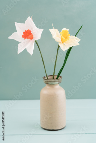 Bouquet of crepe paper daffodil flowers in a vase
