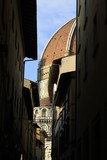 Isolated portion of the famous marble, decorated dome on the church in Florence as seen from an alleyway nearby the sqaure, Tuscany, Italy