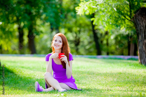 Poster Redhead girl with cup of coffee