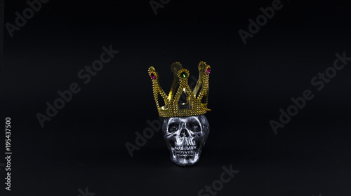 crown and skull on a black background
