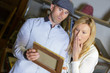 excited emotional woman and man discovered painting