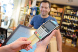 Card payment in liquor store - 195450182