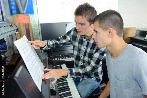 Fototapeta young men with an electric piano