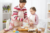 Mother and daughter cook at home. Kitchen interior, healthy food concept - 195452306