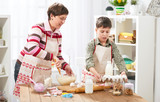 Mother and son cooking at home. Happy family. Healthy food concept - 195452575