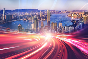 Motion speed light effect with Hong Kong cityscape on background