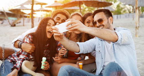 Happy young people taking selfies