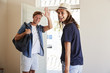 Portrait Of Couple With Luggage Leaving Home For Vacation