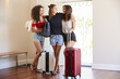 Group Of Female Friends Arriving At Summer Vacation Rental