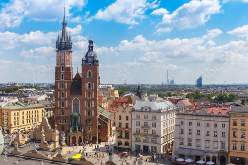 .View of the mariacki church and the roof of the building sukiennice from the height of the town hall building in the Polish city of Krakow. © karp5