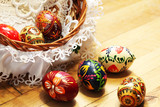 Traditional Easter basket and colored eggs, wooden background - 195495784