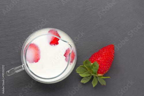 Keuken foto achterwand Milkshake strawberries with milk