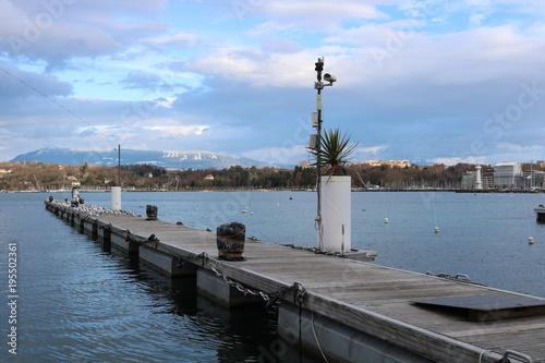 Leinwanddruck Bild Steg an der See Promenade