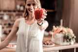 Healthy food. Selective focus of red sweet pepper being in hands of a nice young woman - 195506360