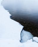 Partially frozen lake shore winter landscape - 195569196