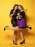 Two beautiful elegant women celebrate party and drinking champagne. - 195571727
