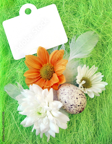Foto op Canvas Natuur Easter still-life with flowers, eggs, feathers on a green sisal fiber with a sign