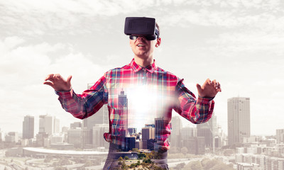 Guy wearing checked shirt and virtual mask stretching hands and