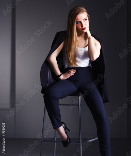 Young woman sitting on a chair . Young woman