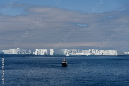 Antarctic landscape with expedition ship