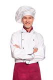 Senior chef smiling - 195612317