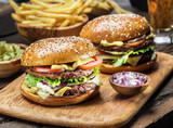 Hamburgers and French fries on the wooden tray. - 195612733