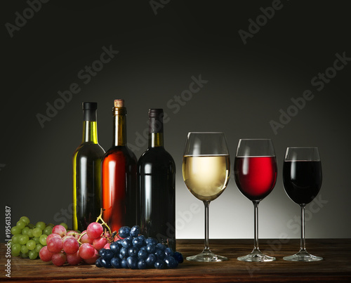 Wine bottles, wine glasses and grapes.