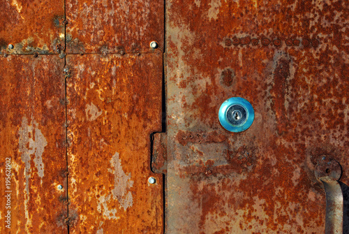 Old Very Rusty Metal Door Background Texture With New Stainless Keyhole Color Palette From Bright