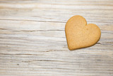 Heart shaped gingerbread on wooden background. - 195640528