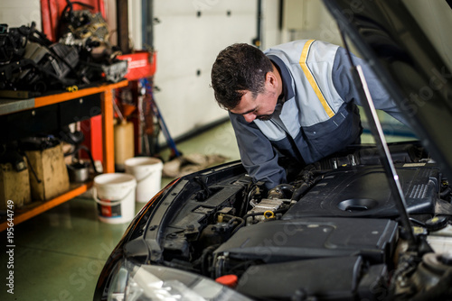Mechanic working on a vehicle in the workshop.
