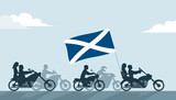 Bikers on motorcycles with scotland flag