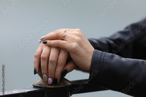 woman's hands with gold rings