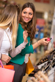 smiling women buying and looking cosmetics. - 195652944