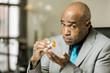 Worried man with an Opioid Prescription Bottle