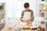 Boy cooking at home, making dough, buns and cookies - 195658306