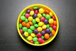 Colorful sweet candies on a grey background