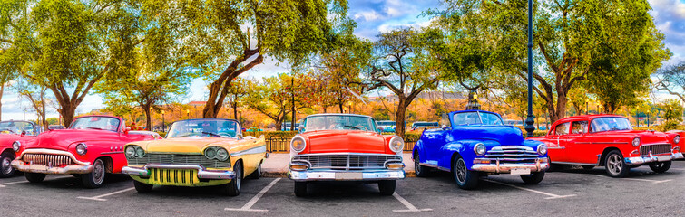 Colorful group of classic cars in Old Havana, an iconic sight in Cuba